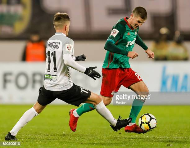 Maksim Paliyenko of FC Tosno and Igor Denisov of FC Lokomotiv Moscow vie for the ball during the Russian Football League match between FC Tosno and...