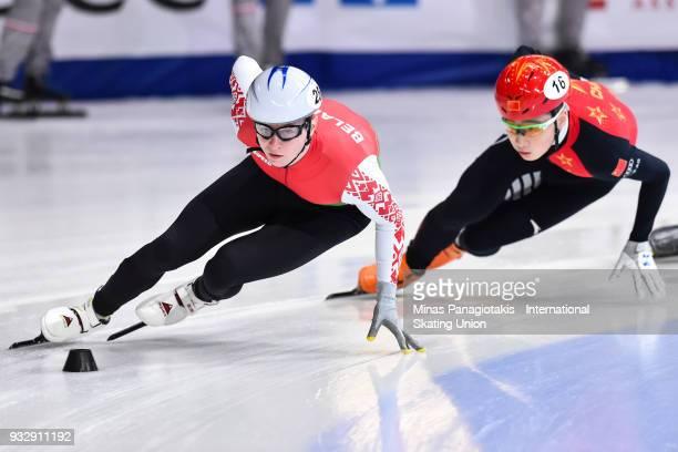 Maksim Siarheyu of Belarus skates against Ziwei Ren of China in the men's 1000 meter preliminaries during the World Short Track Speed Skating...