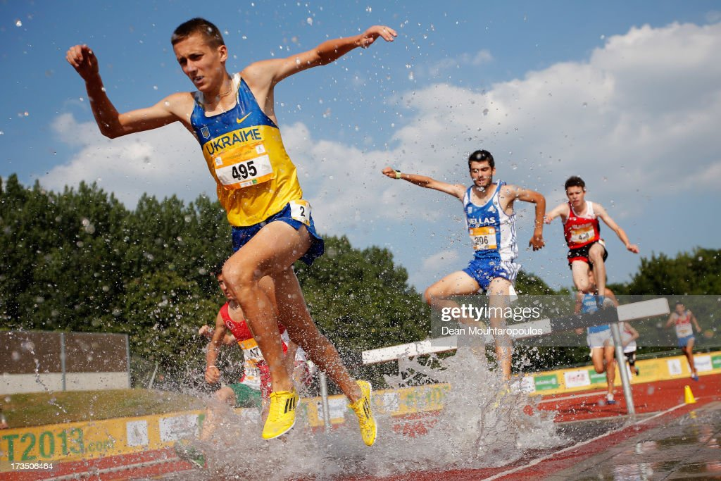 Maksym Pasievin (#495) of Ukraine, Themistoklis Evangelos Milas (#206) of Greece and Marc Bill (#438) of Switzerland compete in the 2000m Boys steeple race during the European Youth Olympic Festival held at the Athletics Track Maarschalkersweerd on July 15, 2013 in Utrecht, Netherlands.