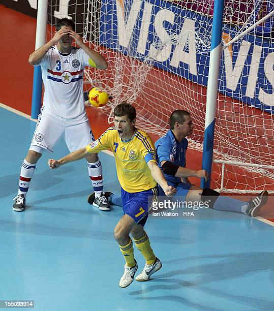 Maksym Pavlenko of the Ukraine celebrates scoring a goal during the FIFA Futsal World Cup Group A match between Ukraine and Paraguay at the Indoor...