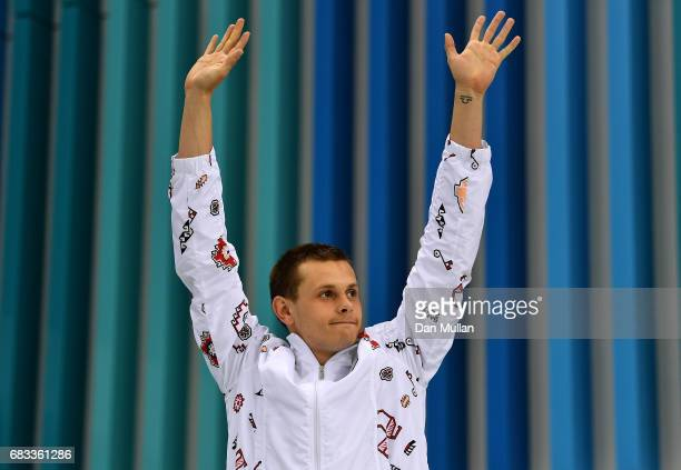 Maksym Shemberev of Azerbaijan celebrates on the podium following victory in the Mens Swimming 400m Individual Medley during day four of Baku 2017...