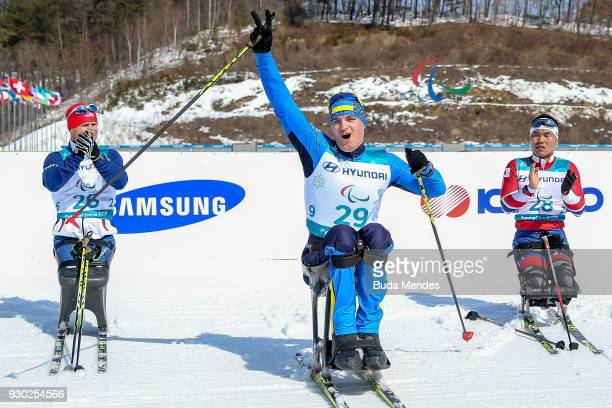 Maksym Yarovyi of Ukraine celebrates winning gold during the Men's 15km Sitting CrossCountry event at Alpensia Biathlon Centre during day two of the...