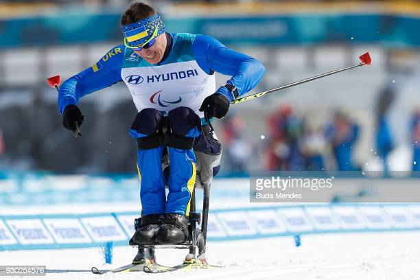 Maksym Yarovyi of Ukraine crosses the finish line in first place during the Men's 15km Sitting CrossCountry event at Alpensia Biathlon Centre during...