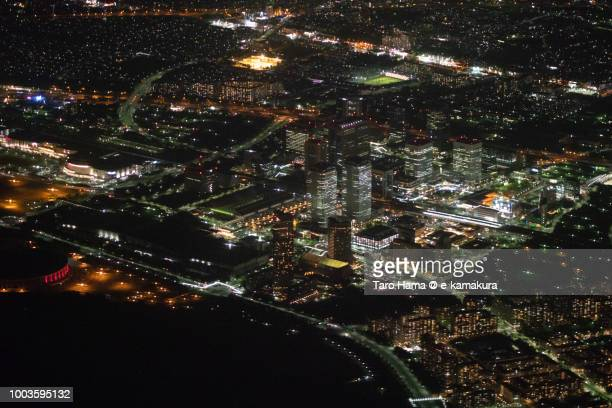 Makuhari Messe in Chiba city in Japan night time aerial view from airplane