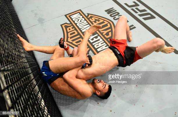 Makwan Amirkhani of Finland attempts to submit Arnold Allen of England in their featherweight fight during the UFC Fight Night event at The O2 arena...