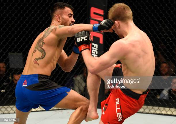 Makwan Amirkhani of Finland punches Arnold Allen of England in their featherweight fight during the UFC Fight Night event at The O2 arena on March 18...