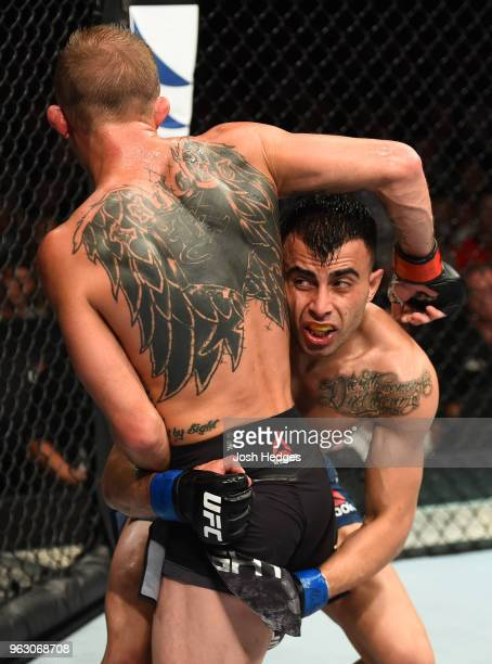 Makwan Amirkhani of Kurdistan attempts to take down Jason Knight in their featherweight bout during the UFC Fight Night event at ECHO Arena on May 27...