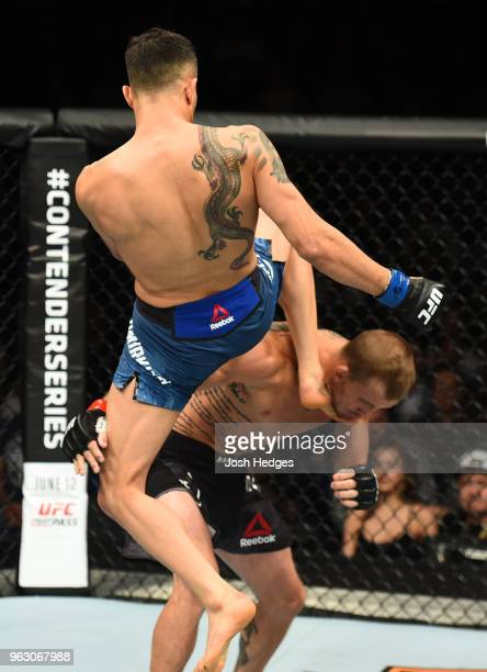 Makwan Amirkhani of Kurdistan knees Jason Knight in their featherweight bout during the UFC Fight Night event at ECHO Arena on May 27 2018 in...