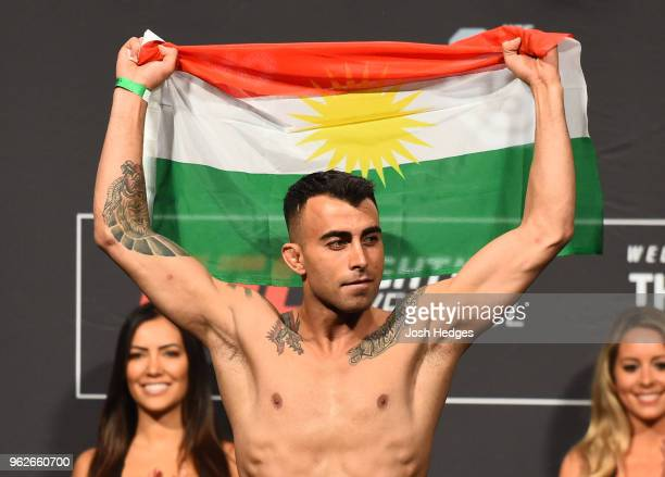 Makwan Amirkhani of Kurdistan poses on the scale during the UFC Weighin at ECHO Arena on May 26 2018 in Liverpool England