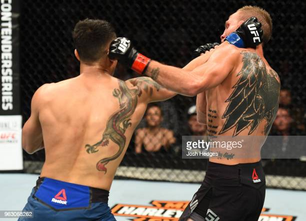 Makwan Amirkhani of Kurdistan punches Jason Knight in their featherweight bout during the UFC Fight Night event at ECHO Arena on May 27 2018 in...