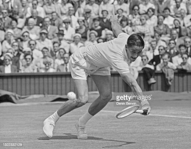 Mal Anderson of Australia reaches to make a backhand return against compatriot Lew Hoad during their Men's Singles Quarter Final match on Centre...
