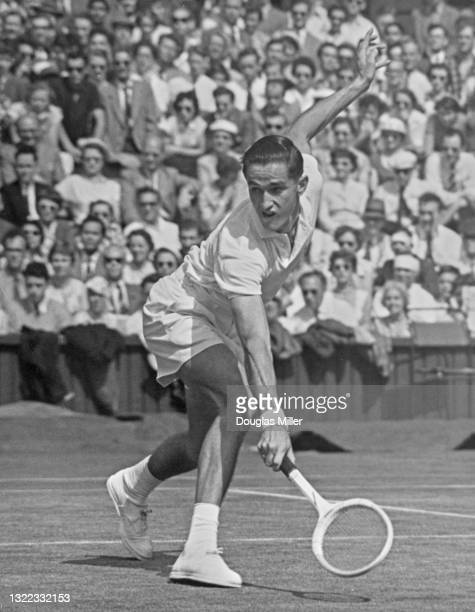 Mal Anderson of Australia reaches to make a backhand return against Nicola Pietrangeli of Italy during their Men's Singles Fourth Round match on...