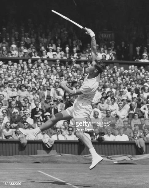Mal Anderson of Australia reaches to make an overhead forehand return against compatriot Lew Hoad during their Men's Singles Quarter Final match on...