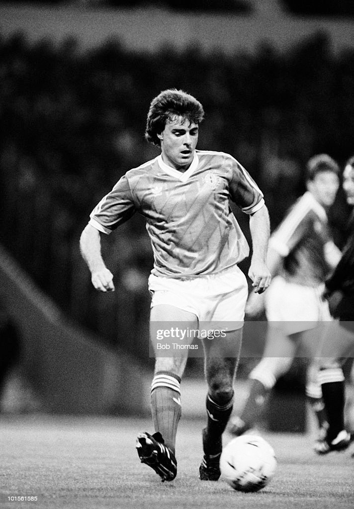 Mal Donaghy of Northern Ireland in action against England during their European Championship qualifying match held at Wembley Stadium, London on 15th October 1986. England beat Northern Ireland 3-0. (Bob Thomas/Getty Images).