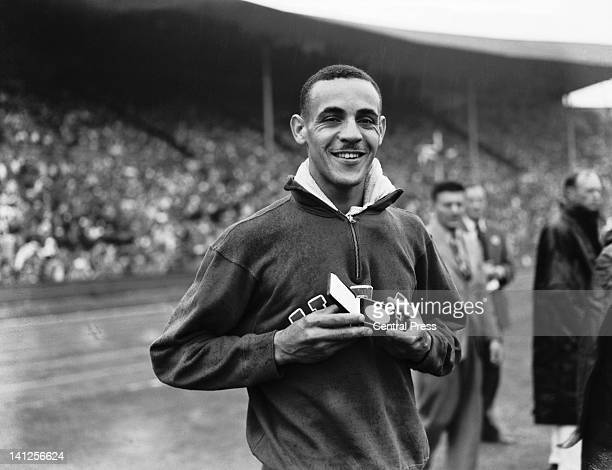 Mal Whitfield holding his gold medal after winning the Men's 800 Metres at Wembley Stadium during the London Olympics 1948 Whitfield won a bronze and...