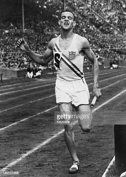 Mal Whitfield of the USA competing in the men's 4 × 400 metres relay at the London Olympics Wembley Stadium August 1948 The US team won the gold...