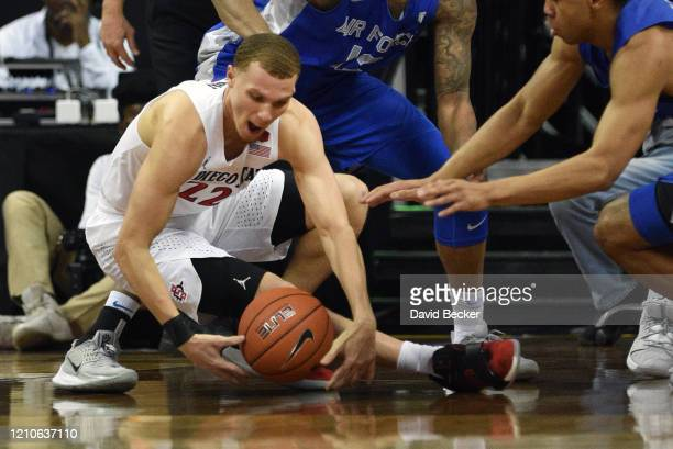 Malachi Flynn of the San Diego State Aztecs grabs a loose ball during a quarterfinal game of the Mountain West Conference basketball tournament...