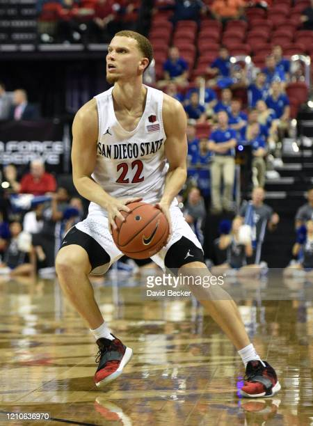 Malachi Flynn of the San Diego State Aztecs looks to pass the ball against the Air Force Falcons during a quarterfinal game of the Mountain West...