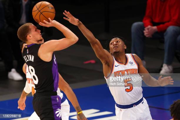 Malachi Flynn of the Toronto Raptors attempts a shot as Immanuel Quickley of the New York Knicks defends at Madison Square Garden on April 11, 2021...