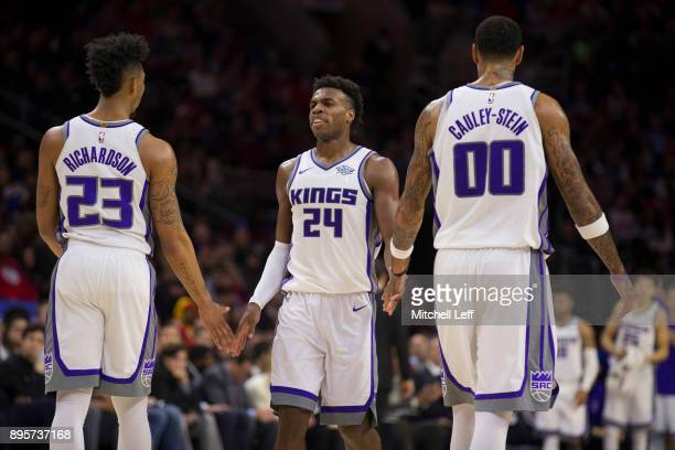 Malachi Richardson Buddy Hield and Willie CauleyStein of the Sacramento Kings react during a timeout in the fourth quarter against the Philadelphia...
