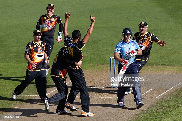Malaesaili Tugaga of Wellington is congratulated after taking the wicket of Lou Vincent of Auckland during the HRV Cup Twenty20 Preliminary Final...