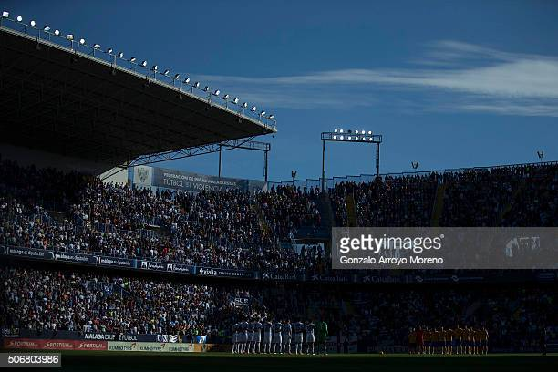 Malaga CF and FC Barcelona players observe one minute of silence in honor of Manuel velazquez and Daniel Rivera prior to start the the La Liga match...