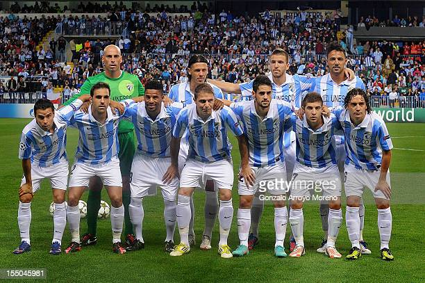 Malaga CF line up prior to the UEFA Champions League group C match between Malaga CF and AC Milan at the Estadio La Rosaleda on October 24 2012 in...