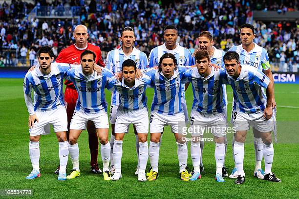 Malaga CF players pose prior to the UEFA Champions League quarter-final first leg match between Malaga CF and Borussia Dortmund at La Rosaleda...