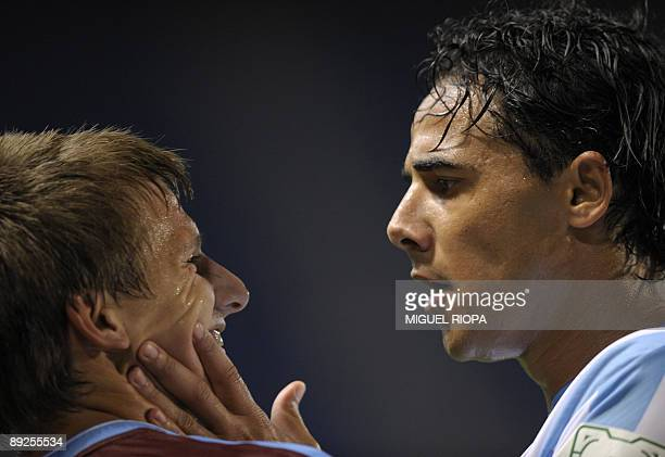 Malaga CF's player Welington argues with Aston Villa´s Marc Albrighton during their group C Peace Cup tournament football match on July 25 2009 at...