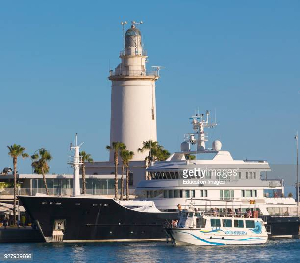 Malaga, Costa del Sol, Malaga Province, Andalusia, southern Spain, Sightseeing boat in Malaga harbor, In background is the lighthouse, referred to...