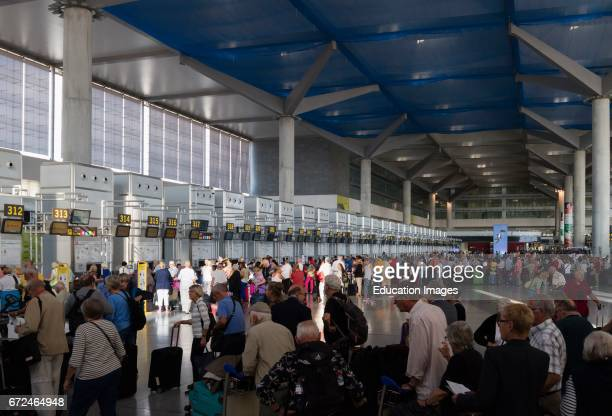 Malaga, Costa del Sol, Malaga Province, Andalusia, southern Spain, Check-in queues in the departure hall of Malaga's Pablo Ruiz Picasso airport.