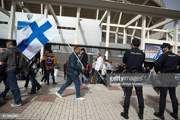 Malaga fan carries the club's flag as he walks ahead La Rosaleda Stadium outdoors before the La Liga match between Malaga CF and Real Madrid CF on...