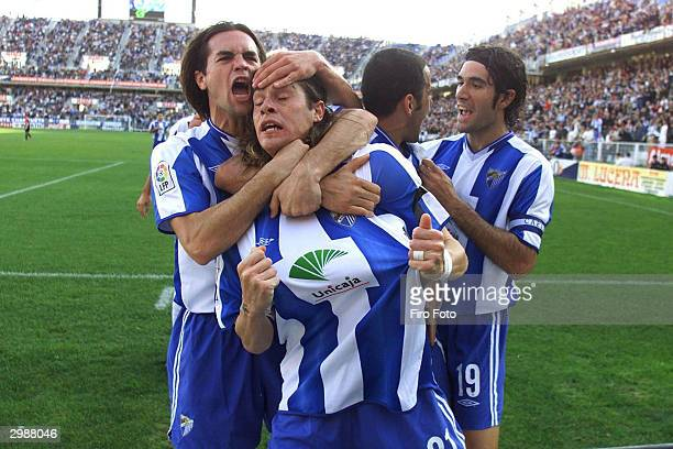 Malaga players celebrate during the Primera Liga game between Malaga and Espanyol at La Rosaleda Stadium February 15 2004 in Malaga Spain