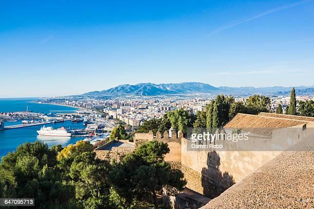malaga port and castle, costa del sol, spain - マラガ県 ストックフォトと画像
