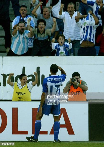 Malagas Salva Ballesta celebrates scoring against Betis during their Spanish League match at the La Rosaleda stadium in Malaga 23 October 2005 AFP...