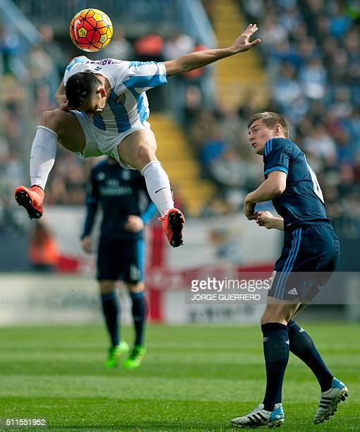 Malaga's Brazilian forward Charles Dias de Oliveira vies with Real Madrid's German midfielder Toni Kroos during the Spanish league football match...