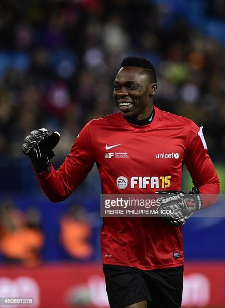 Malaga's Cameroonian goalkeeper Idriss Kameni smiles during the second match of the 'Champions for Life' charity games organized by the Professional...