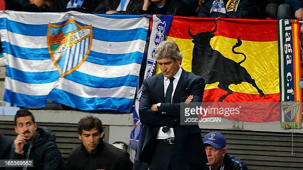 Malaga's Chilean coach Manuel Pellegrini reacts during the UEFA Champions League quarterfinal first leg football match Malaga CF vs Borussia Dortmund...