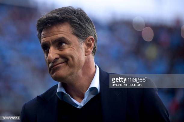 Malaga's coach Jose Miguel Gonzalez Martin del Campo 'Michel' gestures before the Spanish league football match Malaga CF vs FC Barcelona at La...