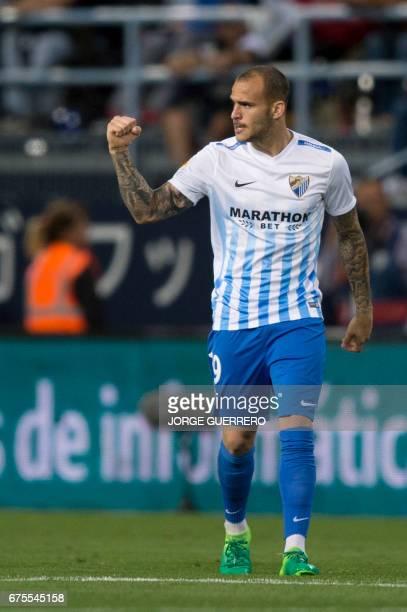 Malaga's coach Michel gestures on the sideline during the Spanish league football match Malaga CF vs Sevilla FC at La Rosaleda stadium in Malaga on...