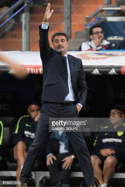 Malaga's coach Michel gives instructions to his players during the Spanish league football match Real Madrid CF against Malaga CF on 25 November 2017...