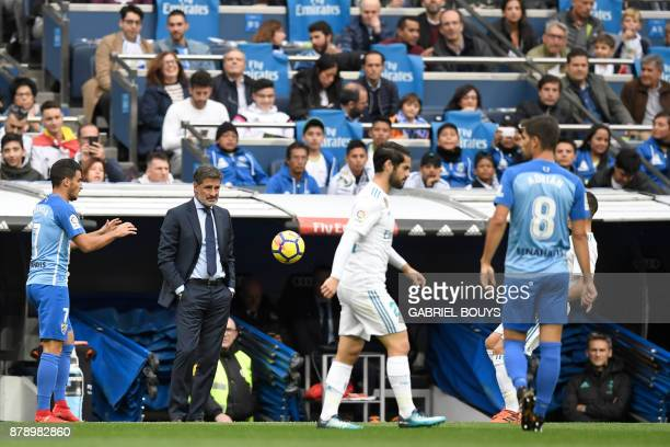 Malaga's coach Michel looks at his players during the Spanish league football match Real Madrid CF against Malaga CF on 25 November 2017 at the...