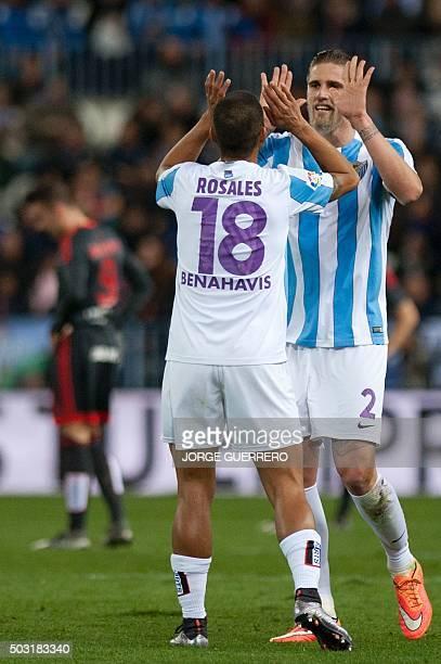 Malaga's defender Raul Albentosa celebrates with Venezuelan defender Roberto Jose Rosales after scoring during the Spanish league football match...