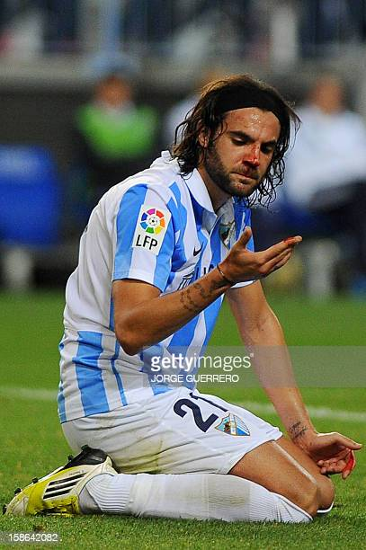 Malaga's defender Sergio Sanchez reacts after being injured during the Spanish league football match Malaga CF vs Real Madrid at La Rosaleda stadium...