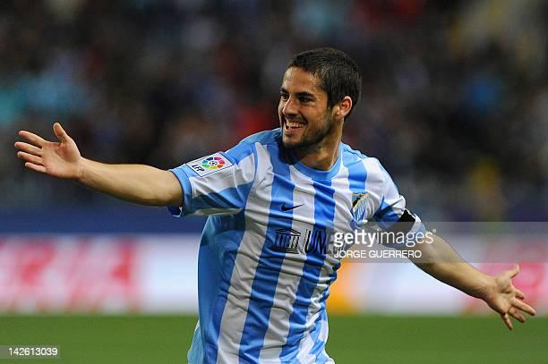 Malaga's midfielder Isco celebrates after scoring during the Spanish league football match Malaga CF vs Real Racing Club de Santander on April 9,...