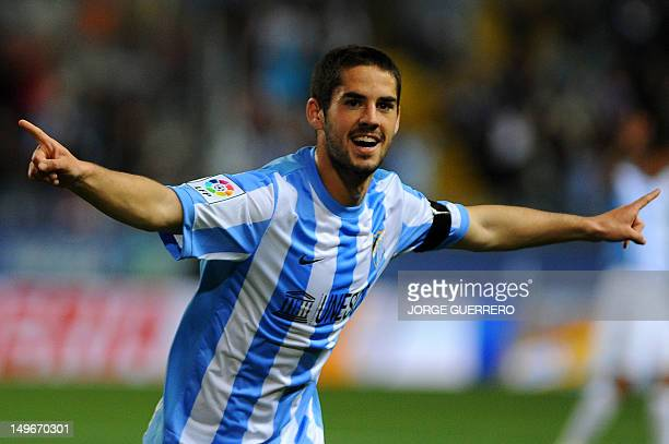 Malaga's midfielder Isco celebrates after scoring during the Spanish league football match Malaga CF vs Real Racing Club de Santander on April 9 2012...