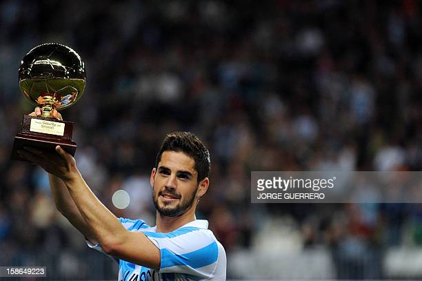 Malaga's midfielder Isco holds Golden Boy trophy before the Spanish league football match Malaga CF vs Real Madrid at La Rosaleda stadium in Malaga...