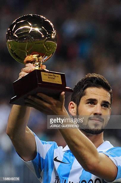 Malaga's midfielder Isco holds Golden Boy trophy before the Spanish league football match Malaga CF vs Real Madrid at La Rosaleda stadium in Malaga...