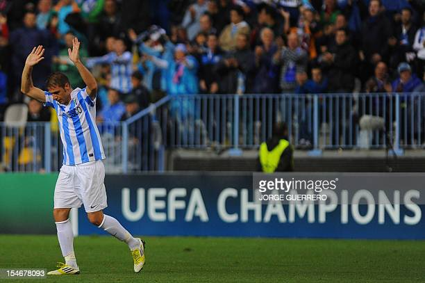 Malaga's midfielder Joaquin Sanchez gestures during the UEFA Champions league football match Malaga CF vs AC Milan on October 24 2012 at the Rosaleda...
