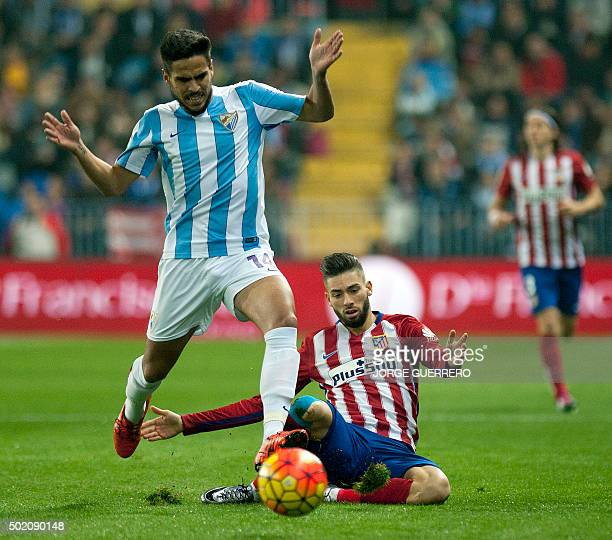 Malaga's midfielder Jose Luis Garcia Recio vies with Atletico Madrid's goalkeeper Miguel Angel Moya during the Spanish league football match Malaga...